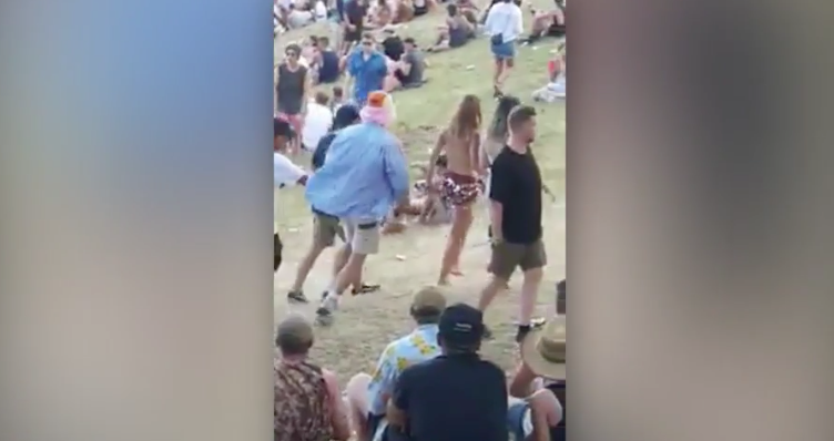 Topless Woman Punches Groper In The Face At NYE Festival