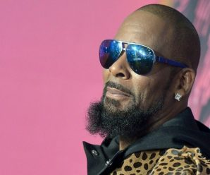 R. Kelly charged with 10 counts of aggravated felony sexual abuse, arrest warrant issued